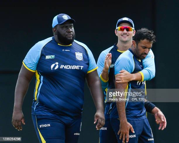 Timothy David , Wahab Riaz and Rahkeem Cornwall of Saint Lucia Kings celebrate the dismissal of Darren Bravo of Trinbago Knight Riders during the...