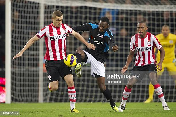 Timothy Derijck of PSV Geoffrey Castillion of Heracles Almelo Marcelo of PSV during the Dutch Eredivisie match between PSV Eindhoven and Heracles...