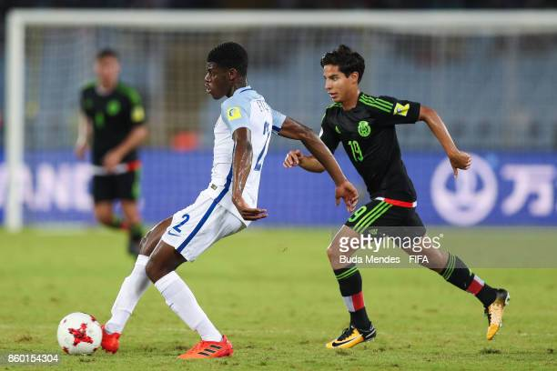 Timothy Eyoma of England battles for the ball with Diego Lainez of Mexico during the FIFA U17 World Cup India 2017 group F match between England and...