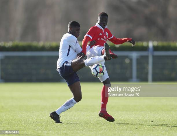 Timothy Eyoma of Spurs battles with Jose Gomes of Benfica during the Premier League International Cup match between Tottenham Hotspur U23 and SL...