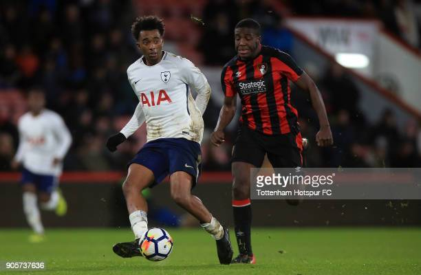 Timothy Eyoma of Tottenham Hotspur holds off pressure from Nnamdi Ofoborh of Bournemouth during the FA Youth Cup match between Bournemouth U18 and...