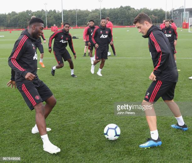 Timothy FosuMensah and Ander Herrera of Manchester United in action during a first team training session at Aon Training Complex on July 13 2018 in...