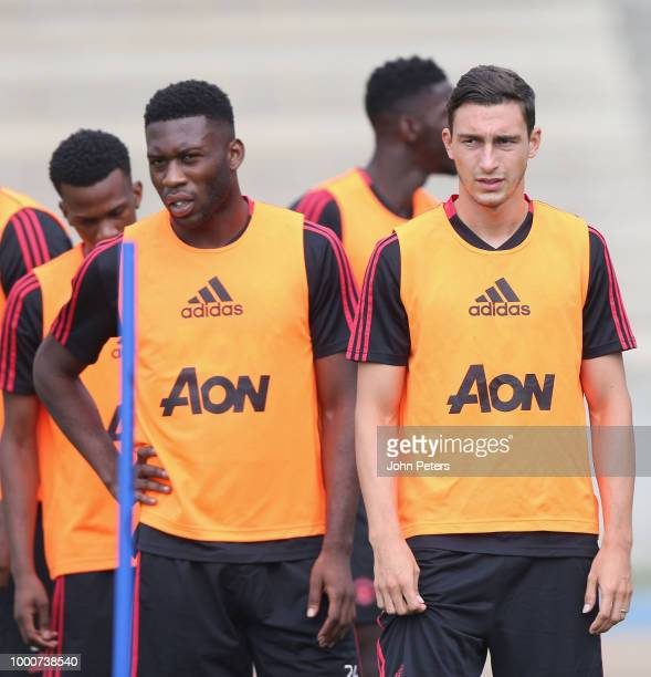 Timothy FosuMensah and Matteo Darmian of Manchester United take part in a first team training session as part of their preseason tour of the USA at...