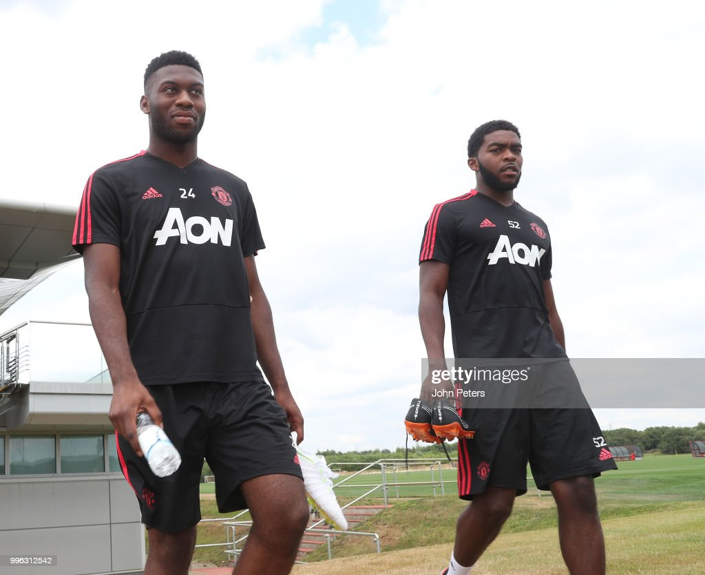 Timothy Fosu-Mensah and Ro-Shaun Williams of Manchester United walk out ahead of a first team training session at Aon Training Complex on July 11, 2018 in Manchester, England.