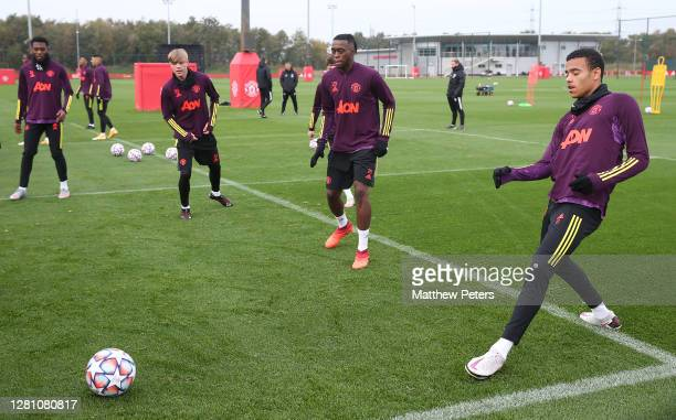 Timothy FosuMensah Brandon Williams Aaron WanBissaka Mason Greenwood of Manchester United in action during a first team training session ahead of the...