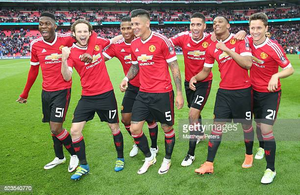 Timothy FosuMensah Daley Blind Antonio Valencia Marcos Rojo Chris Smalling Anthony Martial and Ander Herrera of Manchester United celebrate at the...