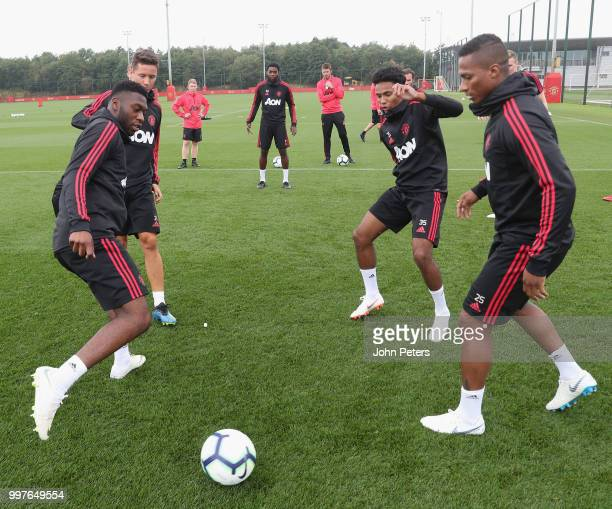 Timothy FosuMensah Demetri Mitchell and Antonio Valencia of Manchester United in action during a first team training session at Aon Training Complex...