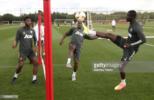Timothy FosuMensah Ethan Laird Eric Bailly of Manchester United in action during a first team training session at Aon Training Complex on August 03...