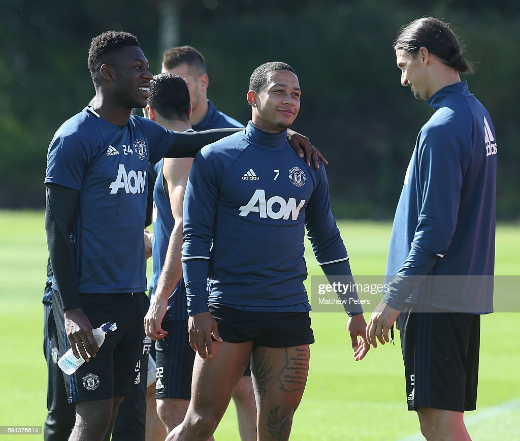 Timothy Fosu-Mensah, Memphis Depay and Zlatan Ibrahimovic of Manchester United in action during a first team training session at Aon Training Complex on August 23, 2016 in Manchester, England.