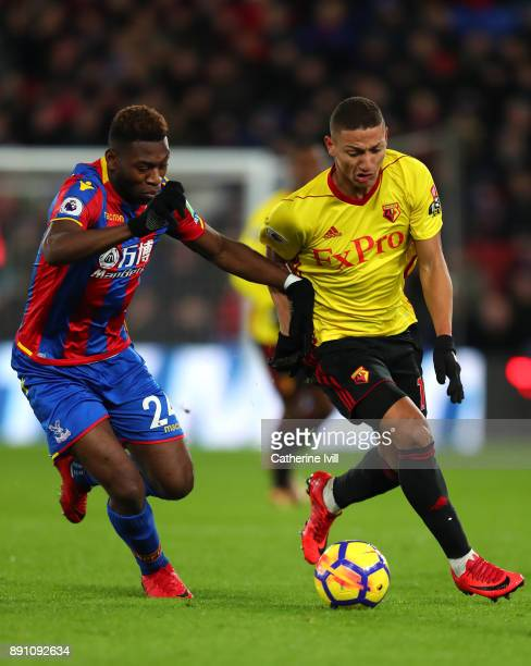 Timothy FosuMensah of Crystal Paalce and Richarlison de Andrade of Watford during the Premier League match between Crystal Palace and Watford at...