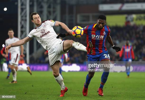 Timothy FosuMensah of Crystal Paalce is challenged by Ashley Barnes of Burnley during the Premier League match between Crystal Palace and Burnley at...