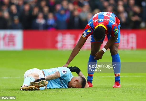 Timothy FosuMensah of Crystal Paalce stands over an injured Gabriel Jesus of Manchester City during the Premier League match between Crystal Palace...