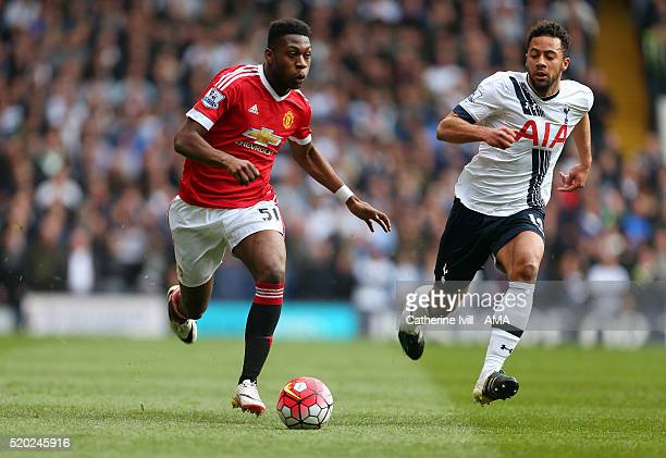 Timothy FosuMensah of Manchester United and Mousa Dembele of Tottenham Hotspur during the Barclays Premier League match between Tottenham Hotspur and...