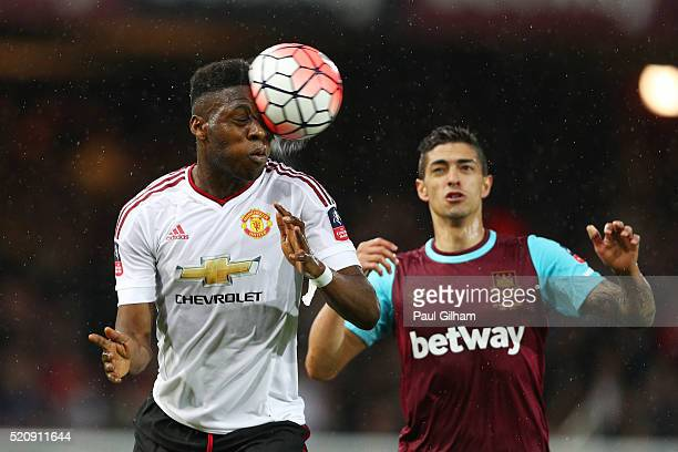 Timothy FosuMensah of Manchester United heads the ball during The Emirates FA Cup sixth round replay between West Ham United and Manchester United at...