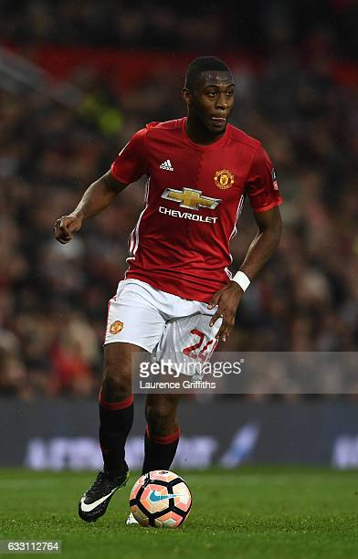 Timothy FosuMensah of Manchester United in action during the Emirates FA Cup Fourth Round match between Manchester United and Wigan Athletic at Old...