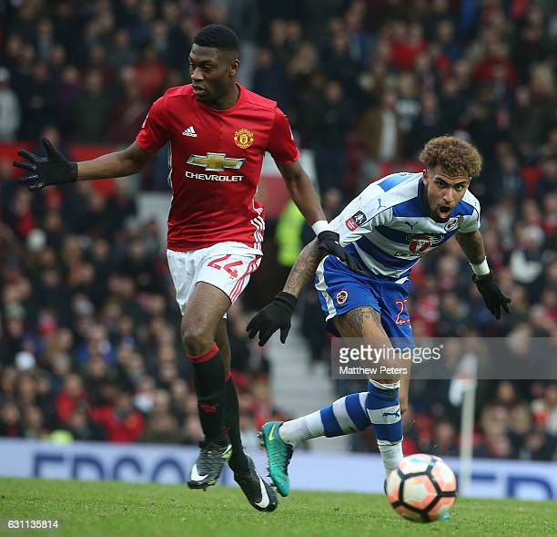 Timothy FosuMensah of Manchester United in action with Danny Williams of Reading during the Emirates FA Cup Third Round match between Manchester...