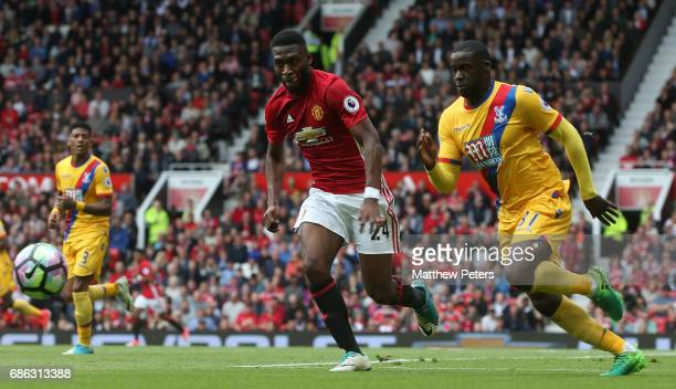 Timothy FosuMensah of Manchester United in action with Jeffrey Schlupp of Crystal Palace during the Premier League match between Manchester United...