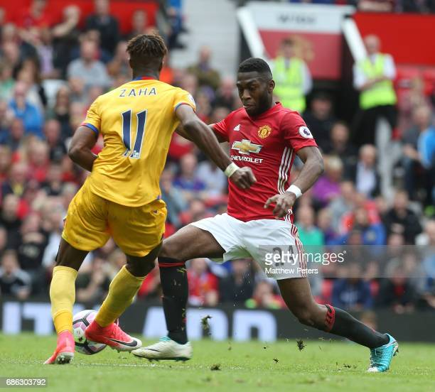 Timothy FosuMensah of Manchester United in action with Wilfried Zaha of Crystal Palace during the Premier League match between Manchester United and...