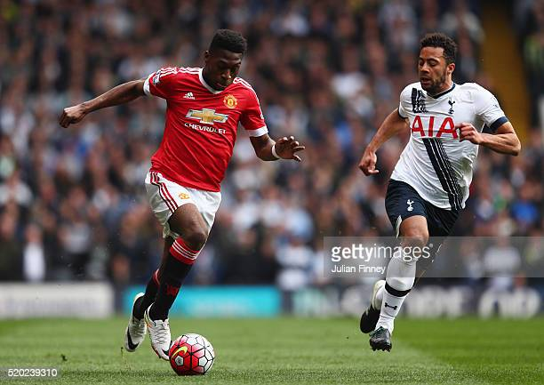 Timothy FosuMensah of Manchester United is chased by Mousa Dembele of Tottenham Hotspur during the Barclays Premier League match between Tottenham...