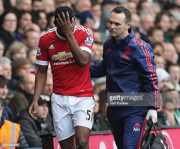 Timothy FosuMensah of Manchester United leaves the match with an injury during the Barclays Premier League match between Tottenham Hotspur and...