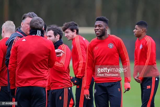 Timothy FosuMensah of Manchester United looks on during a training session ahead of the UEFA Europa League round of 16 first leg match between...