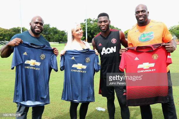 Timothy Fosu-Mensah of Manchester United poses with WWE wrestlers Apollo Crews, Dana Brooke and Titus O'Neil after a training session as part of...