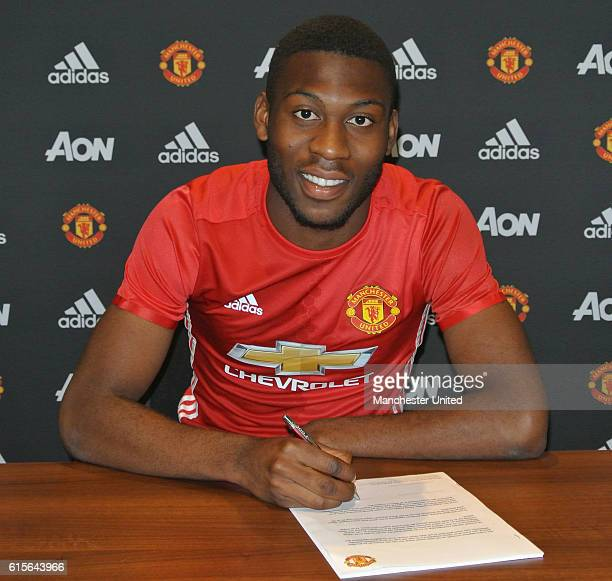 Timothy FosuMensah of Manchester United signs a new contract at Aon Training Complex on October 19 2016 in Manchester England