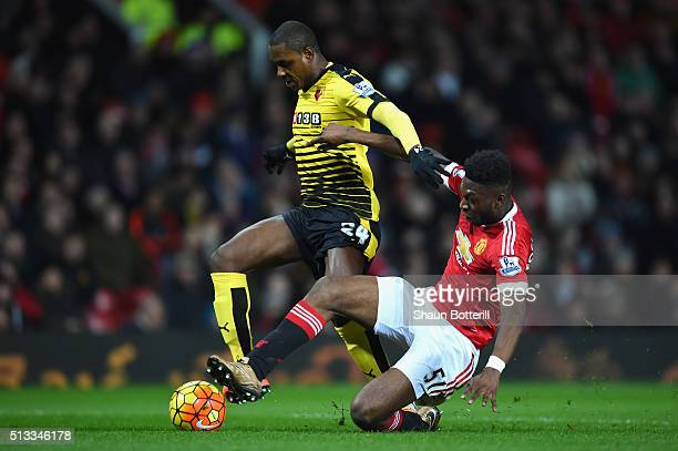 Timothy FosuMensah of Manchester United slides in to tackle Odion Ighalo of Watford during the Barclays Premier League match between Manchester...