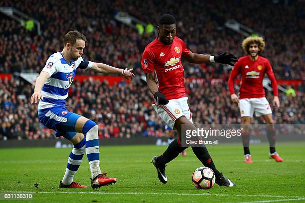 Timothy FosuMensah of Manchester United takes on George Evans of Reading during the Emirates FA Cup third round match between Manchester United and...