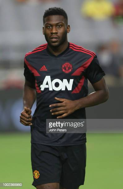 Timothy FosuMensah of Manchester United warms up ahead of the preseason friendly match between Manchester United and Club America at University of...