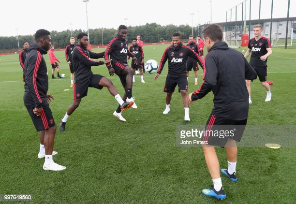 Timothy FosuMensah RoShaun Williams Axel Tuanzebe Antonio Valencia and Ander Herrera of Manchester United in action during a first team training...
