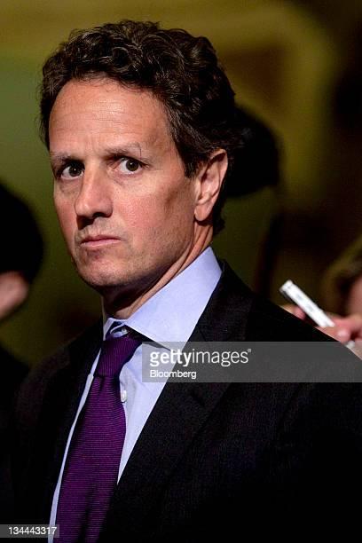 Timothy Geithner US treasury secretary listens as Senate Majority Leader Harry Reid a Democrat from Nevada unseen speaks to the media following the...