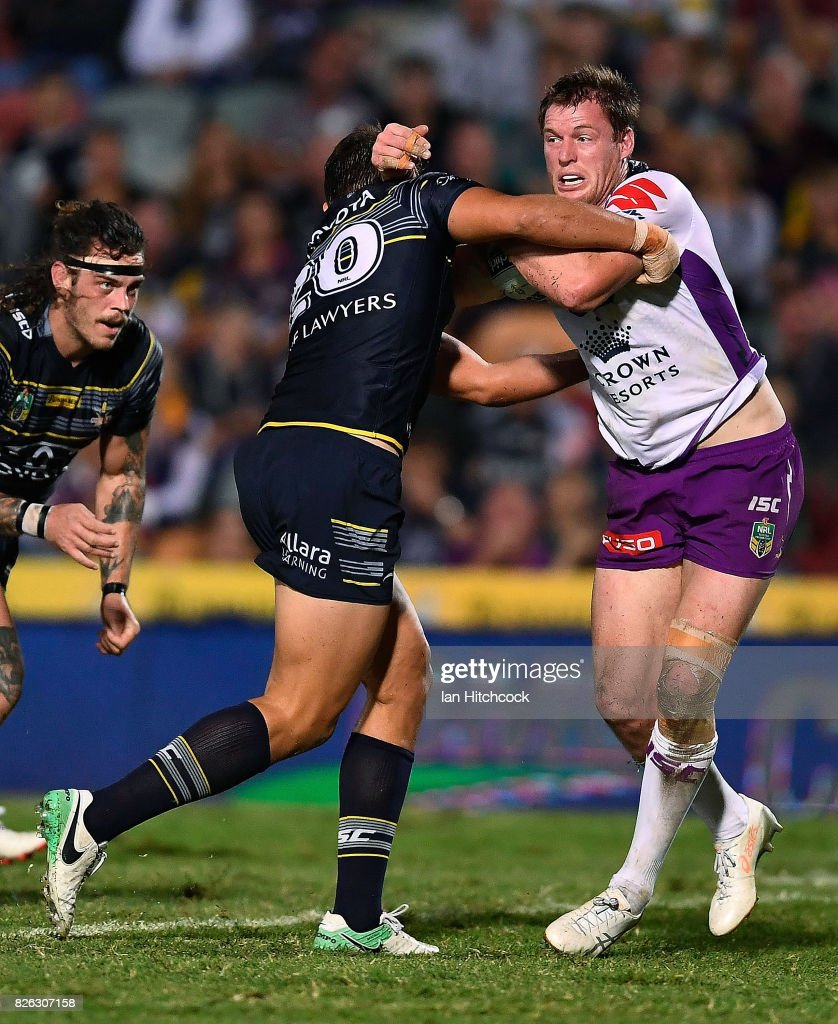 Timothy Glasby of the Storm is tackled by Sam Hoare of the Cowboys during the round 22 NRL match between the North Queensland Cowboys and the Melbourne Storm at 1300SMILES Stadium on August 4, 2017 in Townsville, Australia.