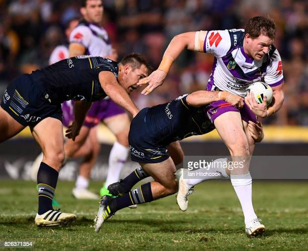 Timothy Glasby of the Storm makes a break during the round 22 NRL match between the North Queensland Cowboys and the Melbourne Storm at 1300SMILES...