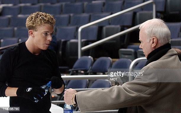 WASHINGTON DC Timothy Goebel of the US talks with coach Frank Carroll during a practice session at the MCI Center on Friday March 21 in preparation...