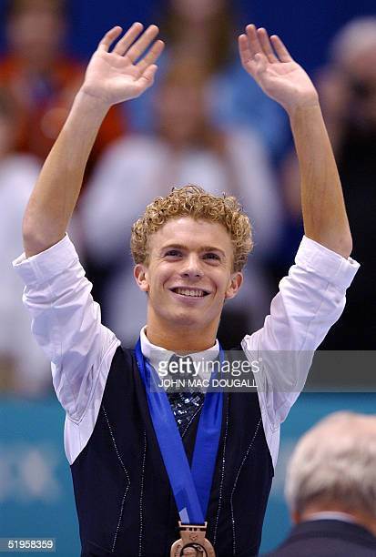 Timothy Goebel of the US waves to the public after winning the bronze medal of the men's free program at the Olympic Ice Center 14 February 2002...
