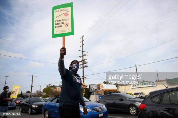 Timothy Goldman protests the killings of people by police including the death of George Floyd and Daunte Wright on April 12, 2021 at the intersection...