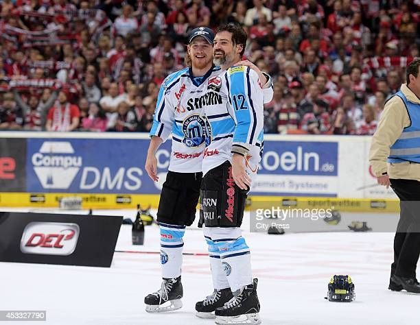 Timothy Hambly and Tyler John Bouck celebrate the championship after game seven of the DEL playoff final on April 29 2014 in Cologne Germany