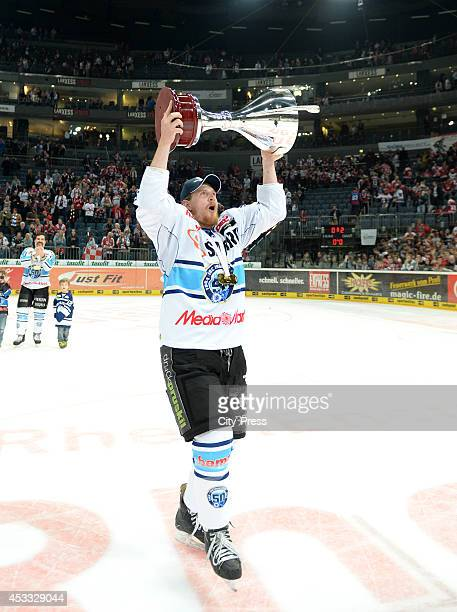 Timothy Hambly holds the trophy after game seven of the DEL playoff final on April 29, 2014 in Cologne, Germany.