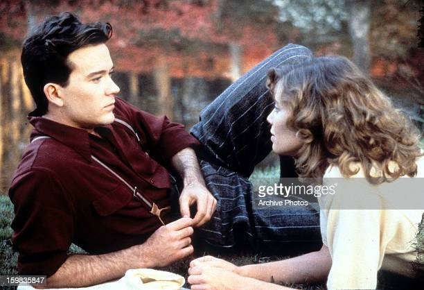 Timothy Hutton and Kelly McGillis relaxing together in a scene from the film 'Made In Heaven' 1987