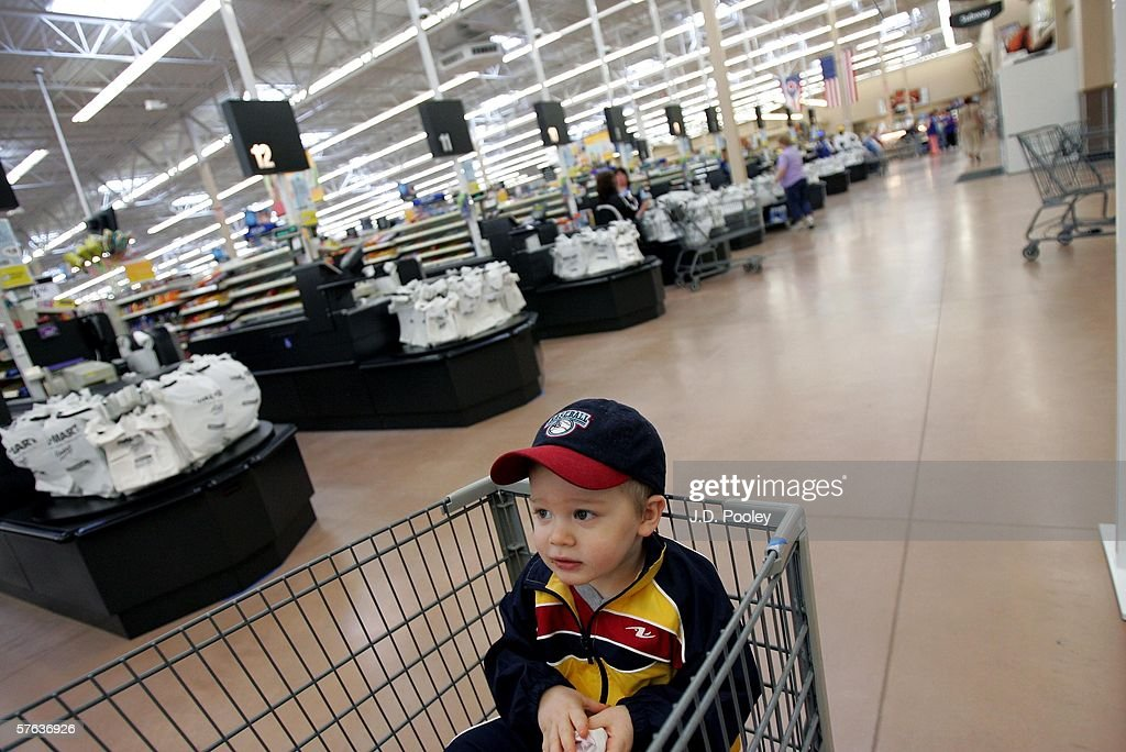 Timothy J. Ellis, 2, sits in a shopping cart inside the new 2,000 square foot Wal-Mart Supercenter store May 17, 2006 in Bowling Green, Ohio. The new store, one of three new supercenters opening today in Ohio, employs 340 people with 60 percent of those working full-time.