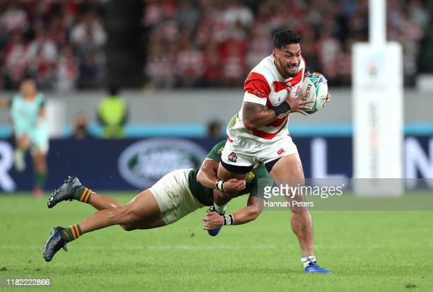 Timothy Lafaele of Japan attempts to break a tackle during the Rugby World Cup 2019 Quarter Final match between Japan and South Africa at the Tokyo...