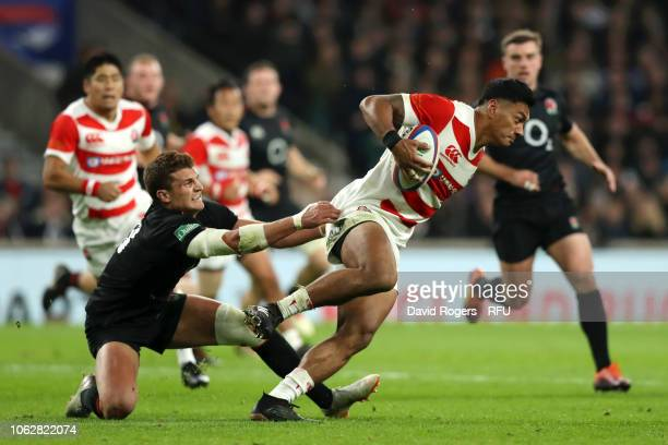 Timothy Lafaele of Japan breaks away from Richard Wigglesworth of England during the Quilter International match between England and Japan at...