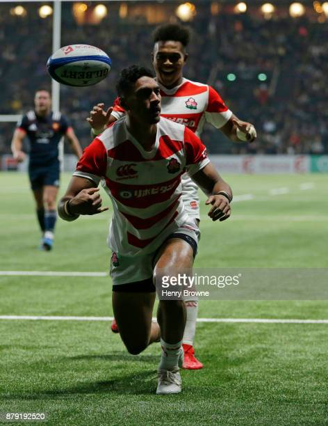 Timothy Lafaele of Japan celebrates after scoring a try during the international rugby union match between France and Japan at U Arena on November...