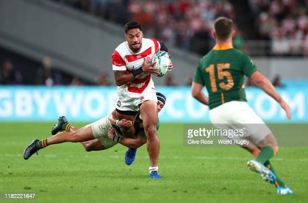 Timothy Lafaele of Japan is tackled by Cheslin Kolbe of South Africa during the Rugby World Cup 2019 Quarter Final match between Japan and South...