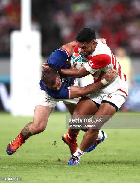 Timothy Lafaele of Japan is tackled by Dmitry Gerasimov of Russia during the Rugby World Cup 2019 Group A game between Japan and Russia at the Tokyo...