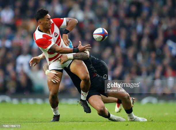 Timothy Lafaele of Japan is tackled by Jack Nowell of England during the Quilter International match between England and Japan at Twickenham Stadium...