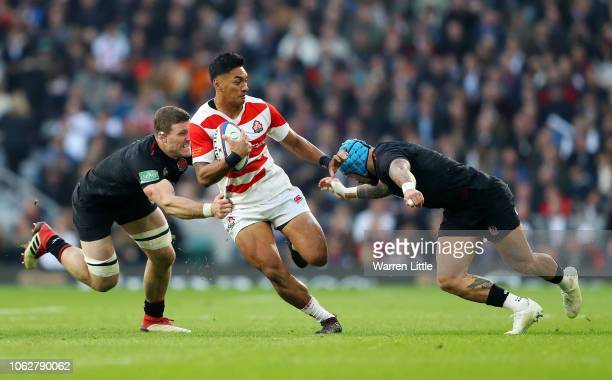 Timothy Lafaele of Japan is tackled by Mark Wilson and Jack Nowell of England during the Quilter International match between England and Japan at...