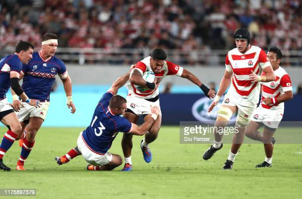 Timothy Lafaele of Japan is tackled by Vladimir Ostroushko of Russia during the Rugby World Cup 2019 Group A game between Japan and Russia at the...