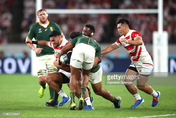 Timothy Lafaele of Japan is tackled during the Rugby World Cup 2019 Quarter Final match between Japan and South Africa at the Tokyo Stadium on...